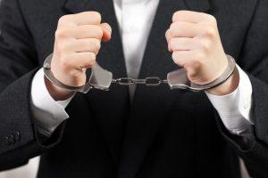 Handcuffs on hands